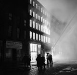 Buildings burning in Manchester after a German air raid on the night of 3 December 1940.