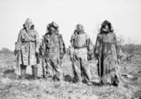 Soldiers demonstrate various styles of camouflage clothing, at Langford near Redlinch in Somerset, 13 March 1941.