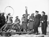 Men of the 1/6th Duke of Wellington's Regiment chat to naval officers on board the Polish steamer SOBIESKI on their way to Norway, 20 April 1940.