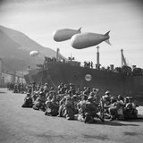 South African troops of 1991 Swaziland Smoke Company wait to board landing craft at Castellammare before sailing for Anzio, January 1944. The unit was responsible for creating smokescreens over the invasion area.