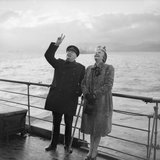 "Winston Churchill gives the ""V"" sign in reply to cheering troops as he leaves the liner QUEEN MARY with his wife Clementine on his return from Canada, September 1943."