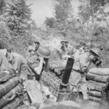 A 4.2-inch mortar of 'S' Troop, 307th Battery, 99th Light Anti-Aircraft Regiment in action at Cassino, Italy, 12 May 1944. The regiment had recently exchanged its Bofors guns for mortars, and this was its first action with the new weapons.