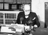 Winston Churchill at a BBC microphone about to broadcast to the nation on the afternoon of VE Day, 8 May 1945.