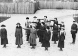 New officer recruits to the Women's Royal Naval Service (WRNS) officers, wearing a mix of civilian dress and uniform, undergo drill at Crystal Palace during the First World War.