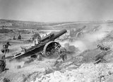 Three 8-inch howitzers of 39th Siege Battery, Royal Garrison Artillery (RGA), firing from the Fricourt-Mametz Valley during the Battle of the Somme, August 1916.