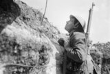 A sentry in the front line trenches at Blaireville using a mirror periscope, 16th April 1916.