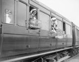 Nurses on a British ambulance train near Doullens with their pet canaries, 27 April 1918.