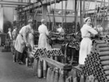 Women munitions workers operating copper turning machines at Royal Shell Factory No.3, part of the Royal Arsenal, Woolwich, May 1918.
