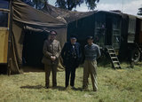 Winston Churchill flanked by the Chief of the Imperial General Staff, Field Marshal Sir Alan Brooke and General Sir Bernard Montgomery, commanding 21st Army Group, at Monty's mobile headquarters in Normandy, 12 June 1944.