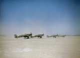 Hawker Hurricane Mark IID 'tank busters' of No. 6 Squadron about to take off from Gabes in Tunisia, 6 April 1943.