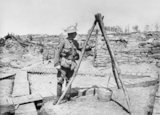 Soldier of the 2nd Australian Division by a gas alarm in the trenches at Croix du Bac, near Armentieres, 18 May 1916.