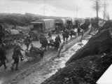 Men of the Middlesex Regiment with horse-drawn Lewis gun carts returning from the trenches near Albert, Somme, September 1916.