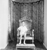 BAGHDAD, IRAQ, CHILD KING FEISAL II (AGED 7) SITTING ON HIS THRONE
