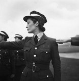 A WAAF cadet in training lines up on parade, RAF Bridgenorth, Shropshire, 1941