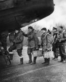 The crew of an RAF bomber board their aircraft for an operation over Germany, Britain, 1941