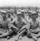 Chinese troops, wearing straw espadrilles, wait for the start of a commando exercise at Pihu Military Training Centre, Fukien, China, 1944