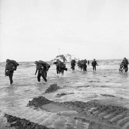 Follow-up troops wade ashore from landing craft on Queen sector of Sword Beach, 7 June 1944.