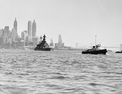 HMS MALAYA leaving New York Navy Yard after four months of repairs following a torpedo hit while on convoy escort duty, 9 July 1941.