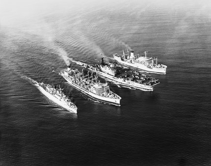 Royal Navy supply ships OLWEN (second from left) and LYNESS (right) delivering fuel and stores to the guided missile destroyer HMS DEVONSHIRE (left) and the Aircraft carrier HMS HERMES, January 1968.