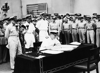 Admiral Sir Bruce Fraser signs the Japanese surrender document for Great Britain on board USS MISSOURI in Tokyo Bay, 2 September 1945.