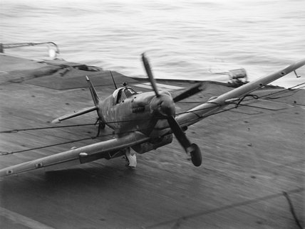 A Supermarine Seafire hits the barrier on HMS INDEFATIGABLE after returning from a strike on the Japanese oil refinery at Pangkalan Brandan, Sumatra, 1 April 1945.