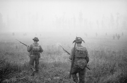 Infantry of  'B' Company, 6th Royal Scots Fusiliers, 15th (Scottish) Division, advance during Operation 'Epsom' in Normandy, 26 June 1944.