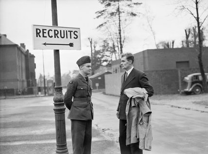 New recruit Michael Suthers arrives at the Royal Air Force Depot at Uxbridge for his selection board, November 1940.