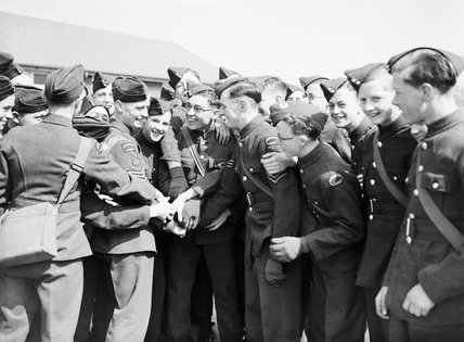 Fellow Air Training Corps cadets give Phillip Fricker an enthusiastic send off as he leaves to join the RAF, Dartford, Kent, April 1942.