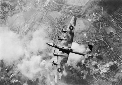 A Handley Page Halifax of RAF Bomber Command over the target during a daylight raid on the oil refinery at Wanne-Eickel in the Ruhr, 12 October 1944.