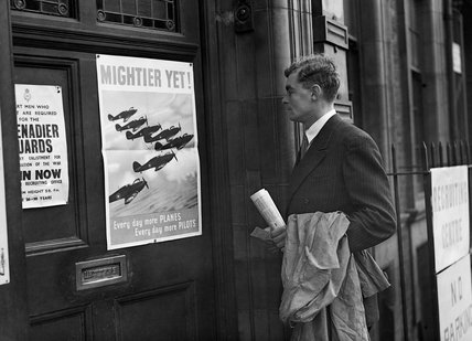 Prospective RAF recruit Michael Suthers arrives at Euston Combined Recruits Centre and is attracted by a poster on the door showing a formation of Hawker Hurricane fighters in flight, November 1940.