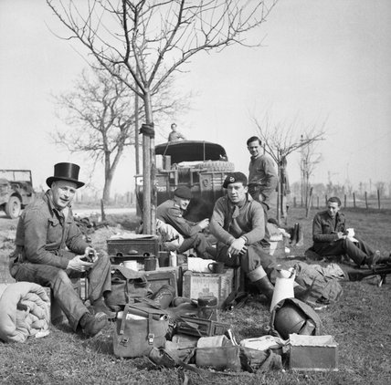 Crews of amphibious DUKW vehicles rest by the roadside east of the Rhine, 25 March 1945.