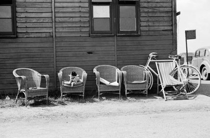 Empty chairs and parked bicycles leaning against a dispersal hut at Hornchurch aerodrome, 7 May 1942.