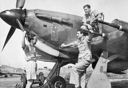 Pilots discuss a sortie by the nose of a Hawker Hurricane Mk IIC of No. 224 Group RAF in north-eastern India, 1943.