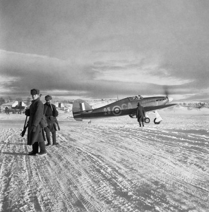 A Hawker Hurricane Mk IIB of No. 134 Squadron RAF taxies out past Russian sentries at Vaenga, near Murmansk, October 1941.