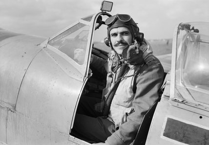 Squadron Leader L C Wade, commanding No. 145 Squadron, sitting in the cockpit of his Supermarine Spitfire HF Mk VIII at Triolo landing ground, south of San Severo in Italy, 12 November 1943.
