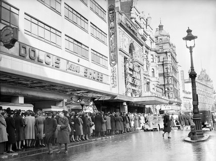 Service personnel and civilians queue for admission to the Empire and Ritz cinemas in London's Leicester Square, 1941.