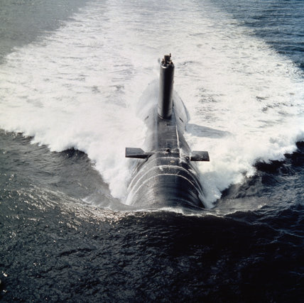 HMS CONQUEROR, the Churchill class nuclear-powered fleet submarine, underway in the early 1970s.  In 1982, the submarine sank the Argentine cruiser ARA BELGRANO during the Falklands War.