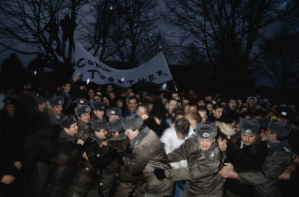 East German guards struggle to restrain a crowd during the opening of the Berlin Wall, November 1989.