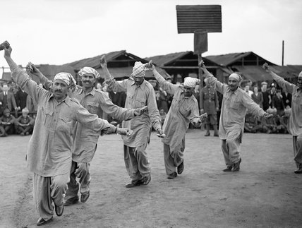Punjabi dancers entertaining troops and locals during a gymkhana held by Indian muleteers of No 32 Animal Transport Company, France, 21 April 1940.
