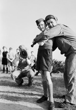 American soldiers teaching British children how to play baseball, 1943.