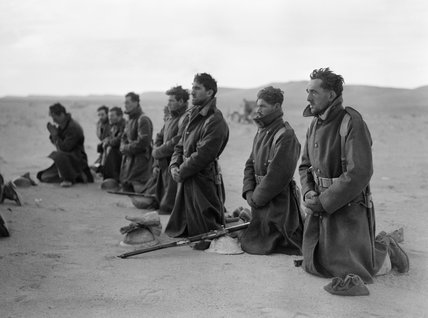 Free French soldiers attend a mass at sunrise during the siege of Bardia in Libya, December 1940.