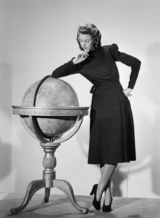 A model wearing a black woollen Utility Atrima dress in 1943.