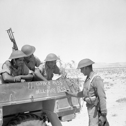 Soldiers of the 4th Indian Division decorate the side of their lorry, North Africa, 21 June 1941.