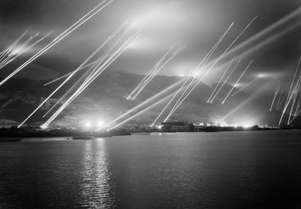 Searchlights pierce the night sky during an air-raid practice on Gibraltar, 20 November 1942.