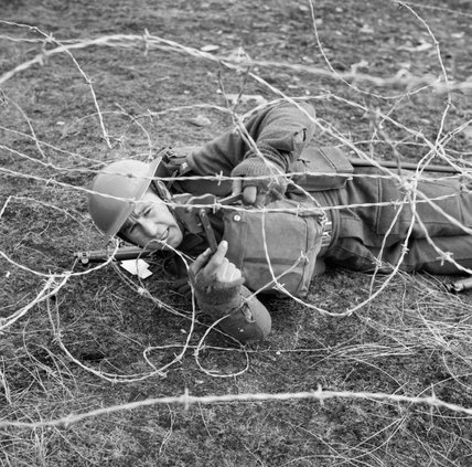 A soldier of the 7th Battalion, The Black Watch, cuts through barbed wire during training at Sumburgh in the Shetland Islands, 20 April 1941.