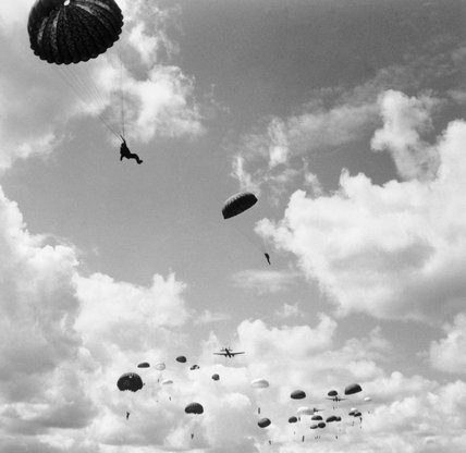 Paratroops jump from a Whitley at RAF Ringway, August 1942.