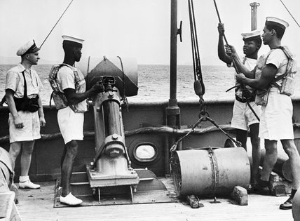 West Indian ratings of the Trinidad Royal Naval Volunteer Reserve operating a depth charge thrower, September 1944.