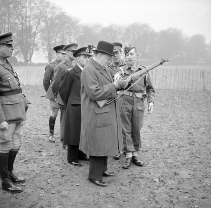 Winston Churchill inspects the new Lee-Enfield No. 4 Mk 1 rifle during a visit to 53rd Division in Kent, 20 November 1942.