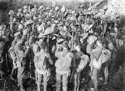 Officers of the 1st Battalion, Irish Guards, read details of the Armistice with Germany to their men, 12 November 1918.