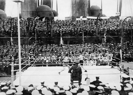 A Middleweight bout at the Grand Fleet Boxing Tournament in 1918 between Chief Carpenter's Mate Gartner (US Navy) and Leading Stoker Roberts (Royal Navy).